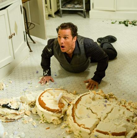 Matthew McConaughey with the destroyed wedding cake.