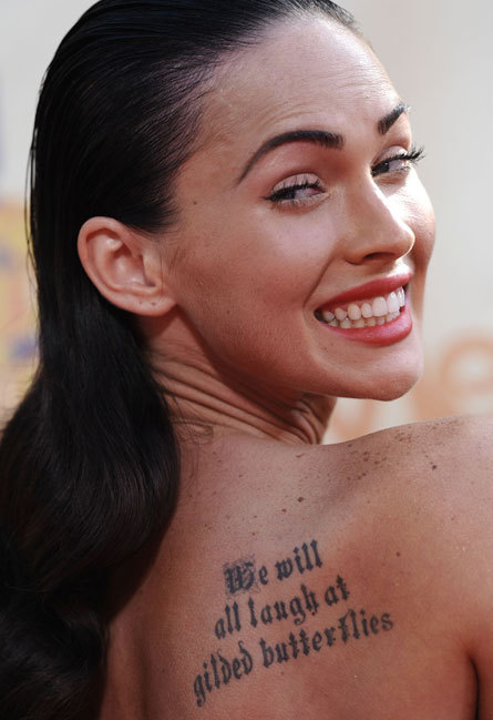 Megan Fox: Back tattoo quote. Actress Megan Fox has several tattoos,