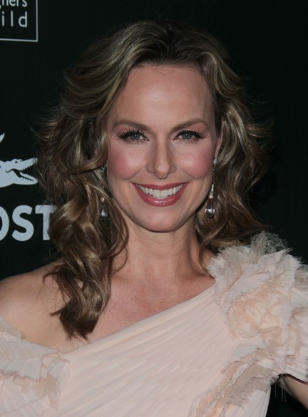 Melora Hardin's curly, highlighted hairstyle