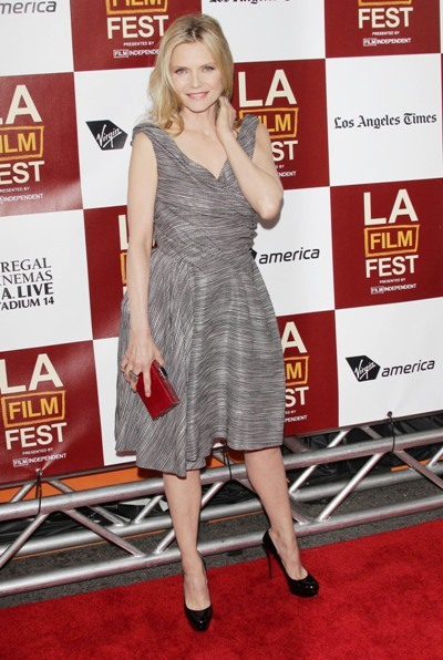 Michelle Pfeiffer poses on the red carpet