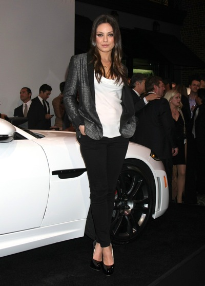 Mila Kunis in black jacket