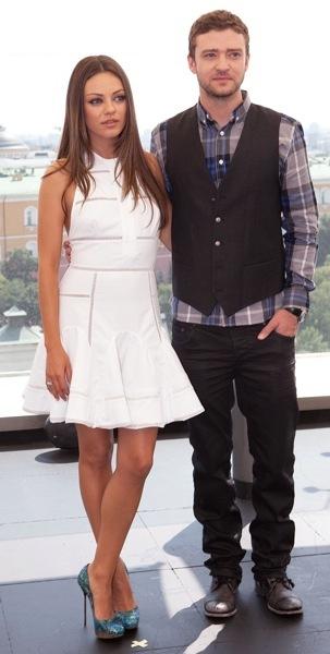 Mila Kunis in white dress