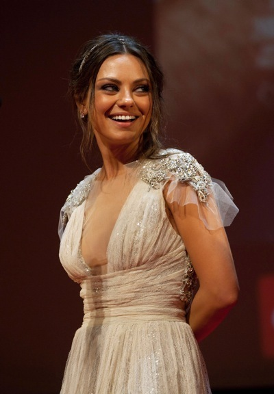 Mila Kunis in a nude dress