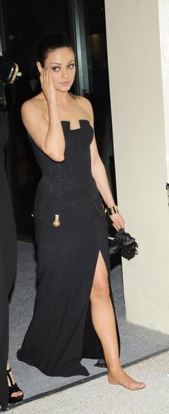 Mila Kunis in a black gown