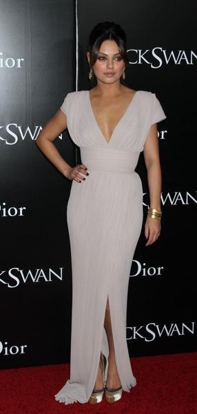 Mila Kunis in a gown