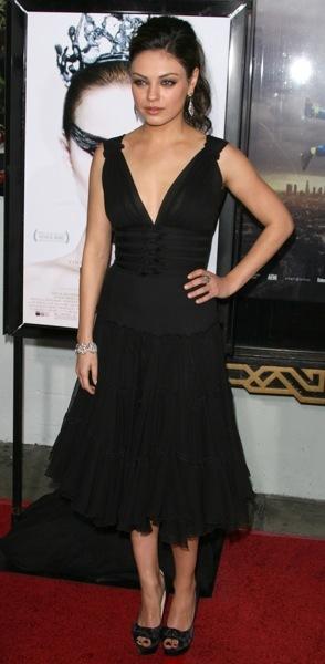 Mila Kunis in a black dress