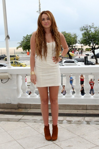 Miley Cyrus in brown suede booties