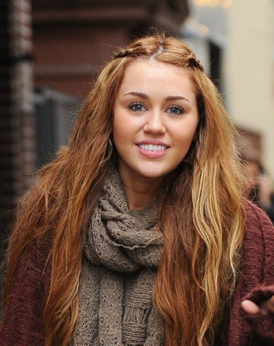 Miley Cyrus in beach waves
