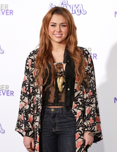 Miley Cyrus in midriff top
