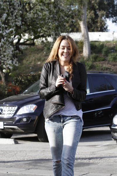 Miley Cyrus in asymmetrical jacket