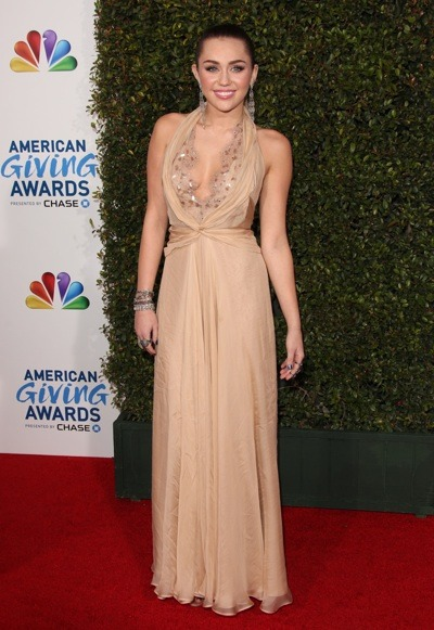 Miley Cyrus in beige halter