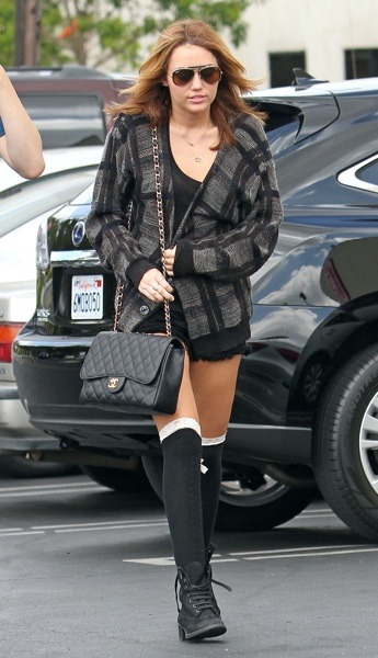 Miley Cyrus in lace-up boots