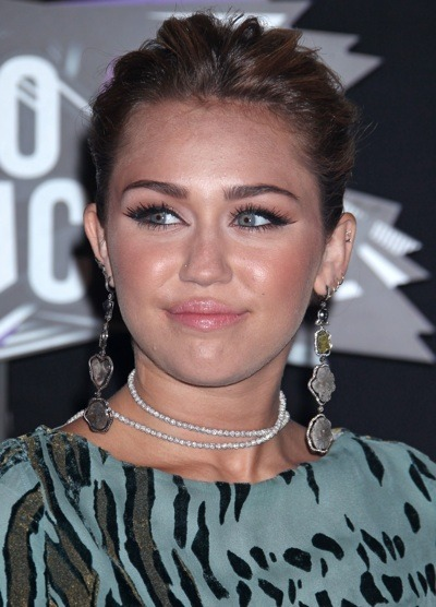 Miley Cyrus with cat-eyes