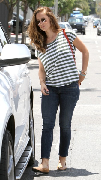 Minka Kelly getting into her car after picking up her dog