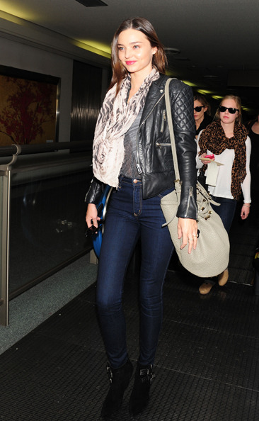 Miranda Kerr arrives at Narita International airport in Japan