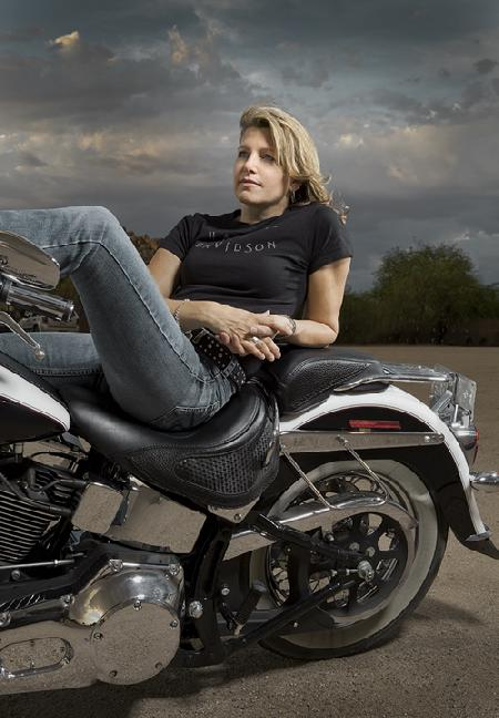 Natalie on motorcycle before storm