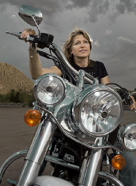 Natalie poses on her Harley-Davidson
