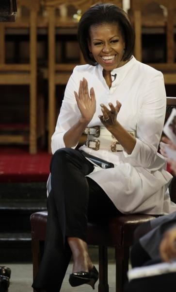 Michelle Obama in a white coat