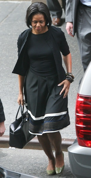 Michelle Obama in green flats