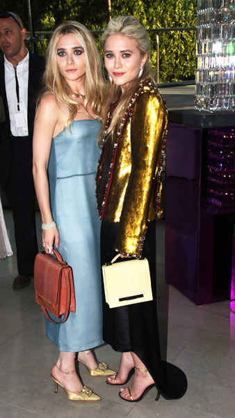 The Olsen twins attends the 2011 CFDA Fashion Awards