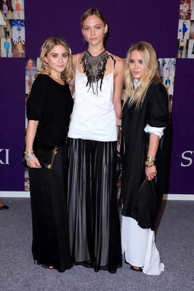 Ashley and Mary-Kate Olsen pose with Sasha Pivovarova at the 2010 CFDA Fashion Awards in NYC. Photo courtesy of Andres O