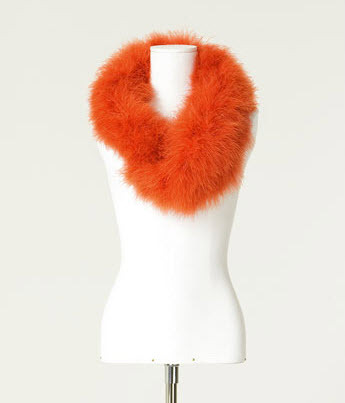 Channel your glamorous side with this orange fur stole from Zara.