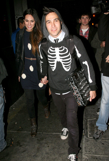 Pete Wentz and his girlfriend leaving a bar