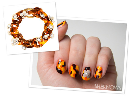 Prada-inspired tortoise shell print nails