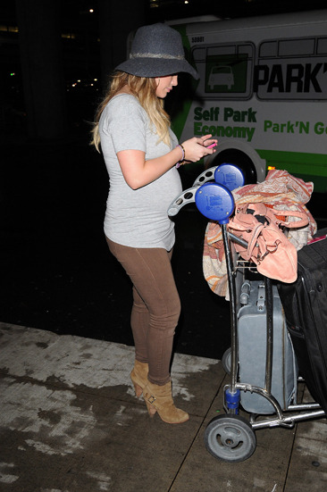 Very pregnant Hilary Duff arrives at Toronto's airport