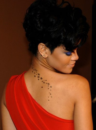 rihanna tattoo shoulder. Rihanna: Stars back tattoo