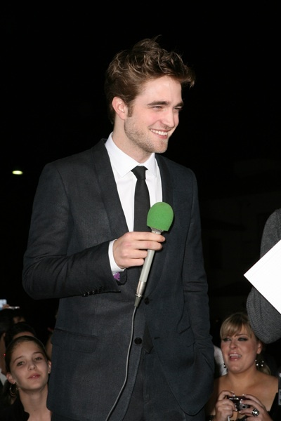 Robert Pattinson with fans at New Moon premiere