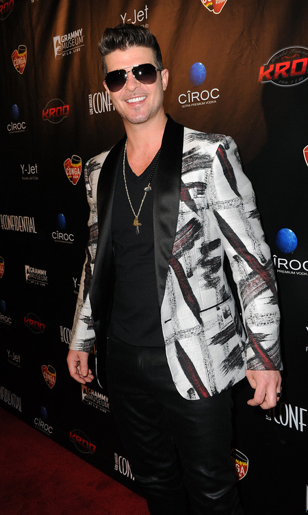 Robin Thicke wears his stunna glasses at night