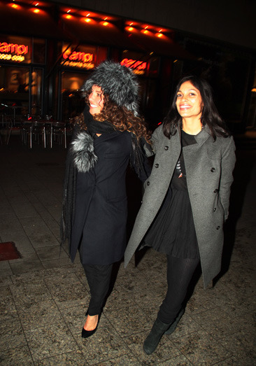 Rosario Dawson and a friend leaving a restaurant in Germany