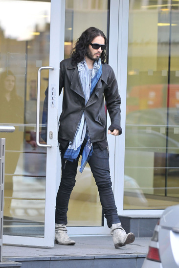 Russell Brand leaves an office in Central London