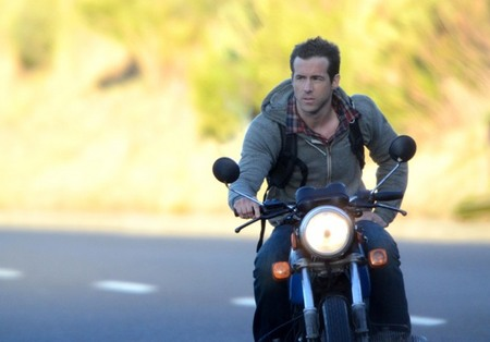 Ryan Reynolds rides motorcycle