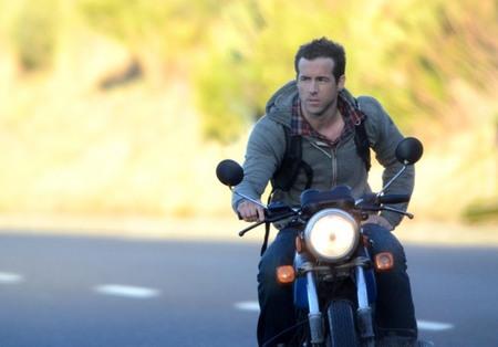 Ryan Reynolds rides motorcycle