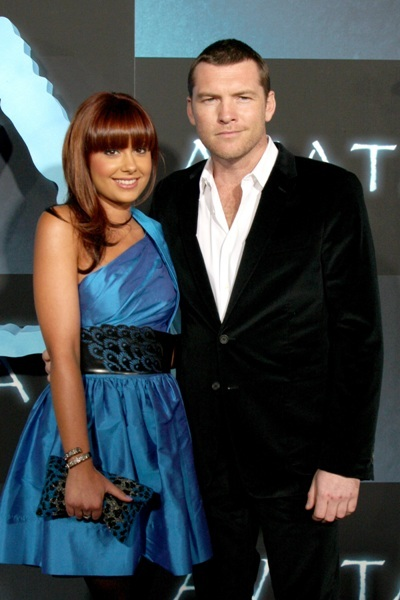 "Sam Worthington and guest at the Premiere of ""Avatar"""