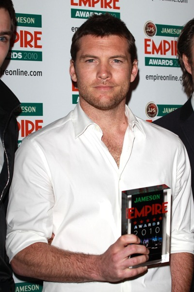 Sam Worthington collecting Best Film award for Avatar