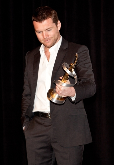 Sam Worthington recieves an award at ShoWest 2010