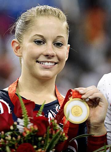 Shawn Johnson with her Gold Medal