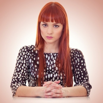 Red Hair - Blunt Bangs and Long Layers. This hairstyle features blunt bangs