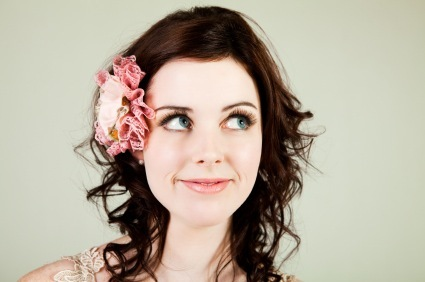 Layered Waves and Spiral Curls with Flower Accent