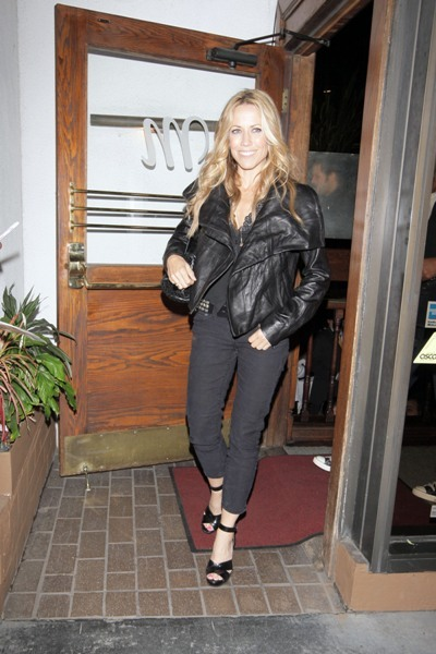 Sheryl Crow rocking a leather jacket during a night out