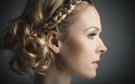 Braided hairstyle - Side braid, loose bun