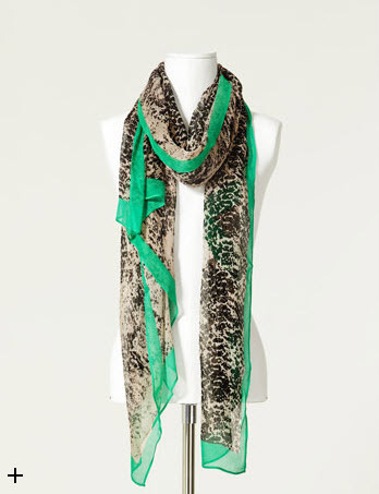 Dress up any outfit with this snake print scarf from Zara.