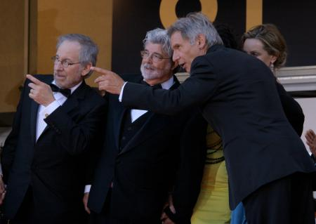 Steven Spielberg, George Lucas and Harrison Ford attending a film festival.