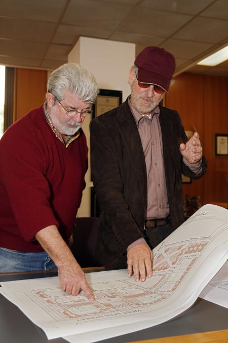George Lucas and Steven Spielberg look at map for USC school