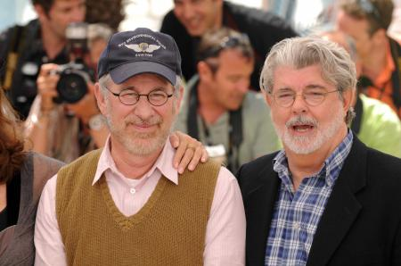 Steven Spielberg smiles next to George Lucas at Cannes.