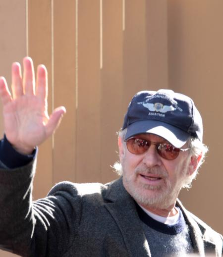 Steven Spielberg waves at his movie premiere