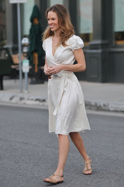 Hilary Swank in beige wrap dress